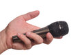 Microphone in the man s hand black on white Royalty Free Stock Image