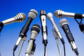 Microphones set on a blue graduated background Royalty Free Stock Photos