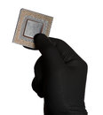 Microprocessor and black gloves Stock Photos