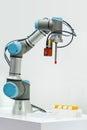 Microscan demonstrates industrial robotic machine using the Vision HAWK smart camera.