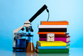 Microscope books and chemical ware on a school table Royalty Free Stock Image
