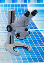Microscope on a cyan test print Royalty Free Stock Photo