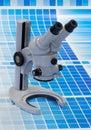 Microscope on a cyan test print Royalty Free Stock Photo