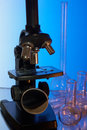Microscope and glasswares Royalty Free Stock Photo