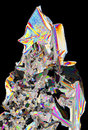 Microscopic view of potassium nitrate crystals in polarized ligh colorful light crossed polarizers Stock Photography