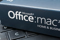 Microsoft office for mac software box with placed on notebook Stock Image