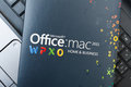 Microsoft office for mac software box with placed on notebook Royalty Free Stock Images