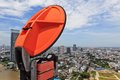 Microwave antenna and view of urban city Royalty Free Stock Photos