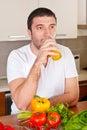 Mid adult man drinking orange juice Stock Photos
