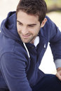 Mid adult man in hooded top outdoors smiling Stock Photos