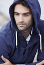 Mid adult man wearing hooded top outdoors Royalty Free Stock Images
