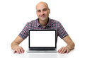 Mid age bald man sitting at desk with laptop Royalty Free Stock Photo