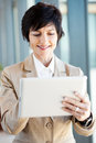 Mid age businesswoman tablet computer Stock Photos