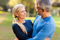 Mid age couple happy embracing outdoors Royalty Free Stock Photography