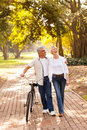 Mid age couple walking outdoors beautiful Stock Image