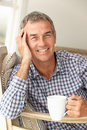Mid age man at home Royalty Free Stock Images