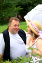 Mid age plus size couple having date in the park sunny day Royalty Free Stock Images