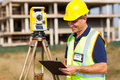 Mid age surveyor land working at construction site with theodolite Royalty Free Stock Photography