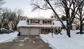 Mid century suburban home on a winter day trip level snowy morning Stock Photography