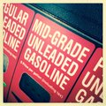 Mid grade unleaded gasoline closeup of red pumps Stock Photography
