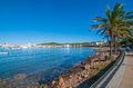 Mid morning sunny walk along Ibiza waterfront.  Warm day on the beach in St Antoni de Portmany Balearic Islands, Spain Royalty Free Stock Photo