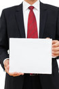 Mid section of a business man with an empty paper happy holding blank sheet on white to write your text Stock Photos