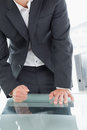 Mid section of businessman with clenched fist on office desk close up a well dressed the at Stock Images