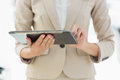 Mid section of a businesswoman using digital tablet closeup young Royalty Free Stock Photography