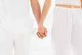 Mid section of couple holding hand on the beach Royalty Free Stock Photo