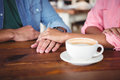 Mid-section of couple holding hands Royalty Free Stock Photo