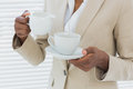 Mid section of elegant businesswoman with tea cup Stock Images