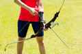 Mid-section of female athlete practicing archery Royalty Free Stock Photo