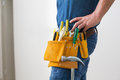 Mid section of handyman with toolbelt around his waist Royalty Free Stock Photo