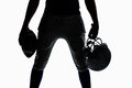 Mid section of silhouette sportsman holding ball and helmet Royalty Free Stock Photo