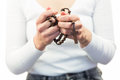 Mid section of woman holding rosary beads Royalty Free Stock Photo