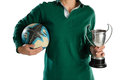 Mid section of woman holding trophy and rugby ball Royalty Free Stock Photo
