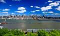The Mid-town Manhattan Skyline on a sunny day Royalty Free Stock Photo