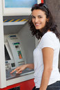 Midadult woman at atm hispanic smiling while introducing pin Stock Images