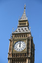 Midday the clock on saint stephens tower westminster housing the famous bell big ben showing noon Royalty Free Stock Image