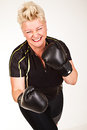 Middelaged fitness woman boxing wearing boxing gloves and having fun Stock Photography