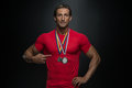 Middle age athlete competitor showing his winning medal male fitness Stock Photos