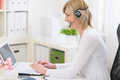 Middle age business woman with headset at work Stock Photos