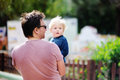 Middle age father with his little son walking outdoors Royalty Free Stock Photo