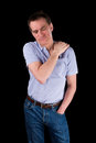 Middle age man holding shoulder in pain black background Royalty Free Stock Photo
