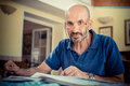Middle age man reading newspaper at home Royalty Free Stock Photo