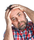 Middle age man suffering from a headache pain portrait of an isolated on white Royalty Free Stock Images