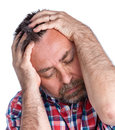 Middle age man suffering from a headache portrait of an with face closed by hand isolated on white Stock Images