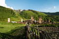 Middle age mountain village with old huts and fence caucasus europe Royalty Free Stock Photos