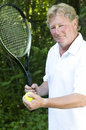 Middle age  tennis player demonstating stroke Royalty Free Stock Photo
