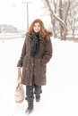 Middle age woman walking in a city during a snowfall beautiful the sidewalk on frigid day the canadian winter Royalty Free Stock Images